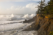 Large waves crash on the rocks along the Oregon coast.