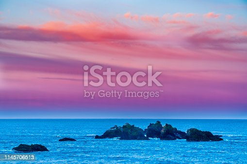 Sunrise on Sea stack formations off the town of Bandon Beach on the Oregon Coast