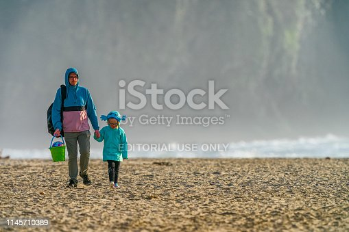 Oregon coast USA on March 22, 2019: Family walking on Bandon Beach on the Oregon Coast