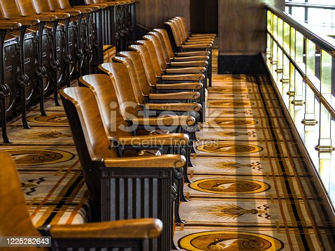 Looking at vintage theater style chairs in the Oregon Senate gallery. This is the public seating area that looks down into the Senate Chamber area. Located at the Oregon State Capital Salem, Oregon.