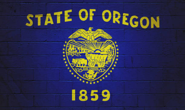 Oregon state flag painted on a wall Flag of the Oregon painted on a brick wall. oregon us state stock pictures, royalty-free photos & images