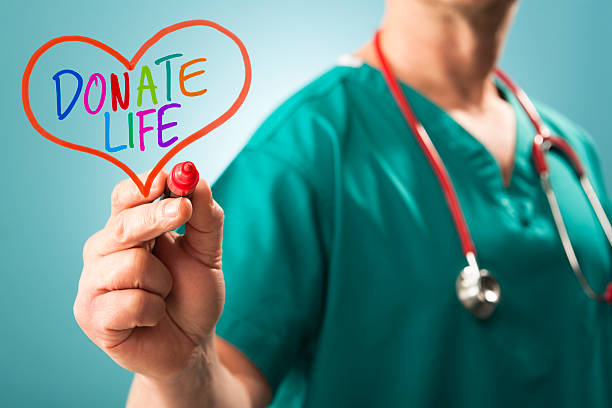 donate life – organ donation call from doctor - organ donation stock pictures, royalty-free photos & images