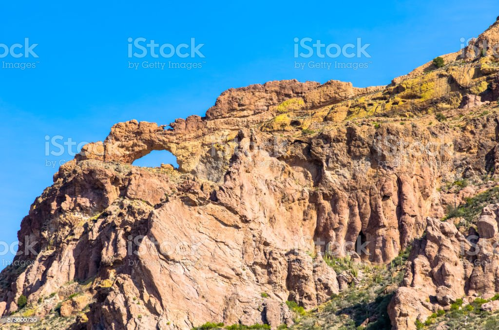 Organ Pipe Cactus National Monument in Arizona's Sonoran Desert - Natural Arch in the Steep Ajo Mountain Range stock photo