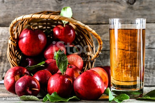 istock Organic apple juice in a glass and delicious apples on table, healthy diet and wellbeing concept 913405650