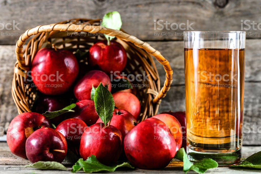 Organic apple juice in a glass and delicious apples on table, healthy diet and wellbeing concept stock photo