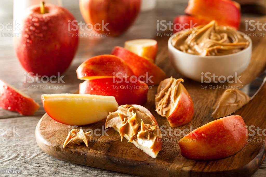 Organic Apples and Peanut Butter stock photo