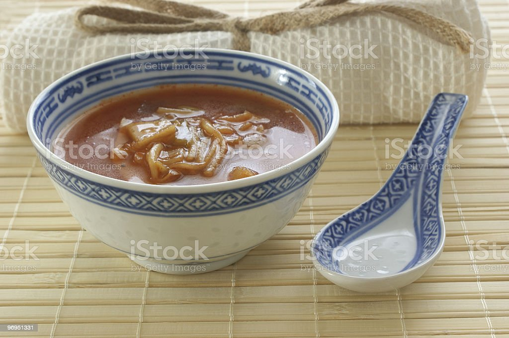 organic asian vegetable soup on a bamboo mat royalty-free stock photo