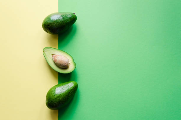 Organic avocado on color background stock photo