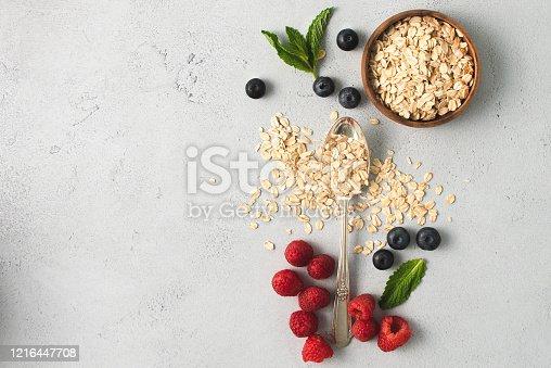 Oatmeal,Raspberries, Strawberries and blueberries in flat lay design.