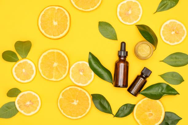 cosméticos bio orgânico com vitamina c c.vitamin soro. creme com vitamina c - c - fotografias e filmes do acervo