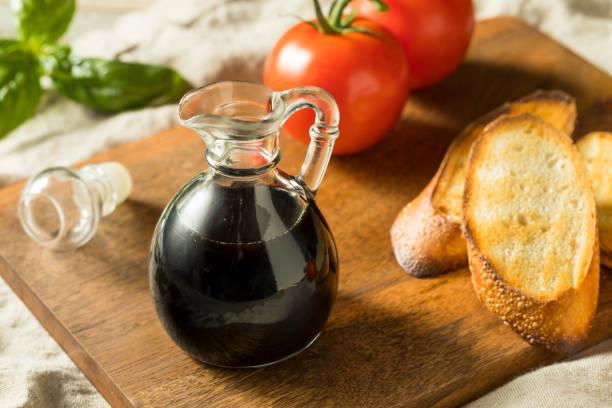 Organic Black Balsamic Vinegar Organic Black Balsamic Vinegar in a Bottle balsamic vinegar stock pictures, royalty-free photos & images