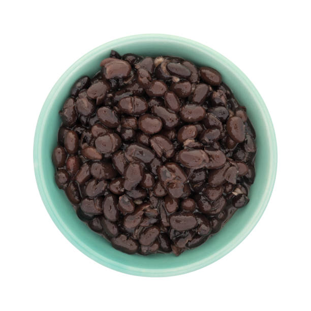 Organic black beans in a green bowl stock photo