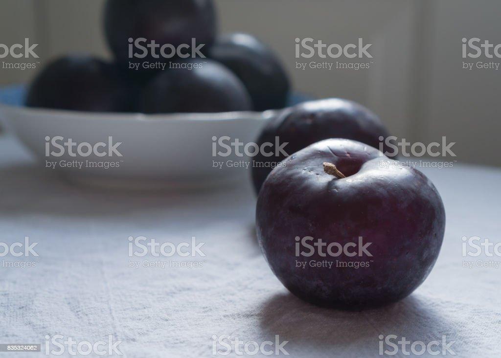 Organic Black Plums stock photo