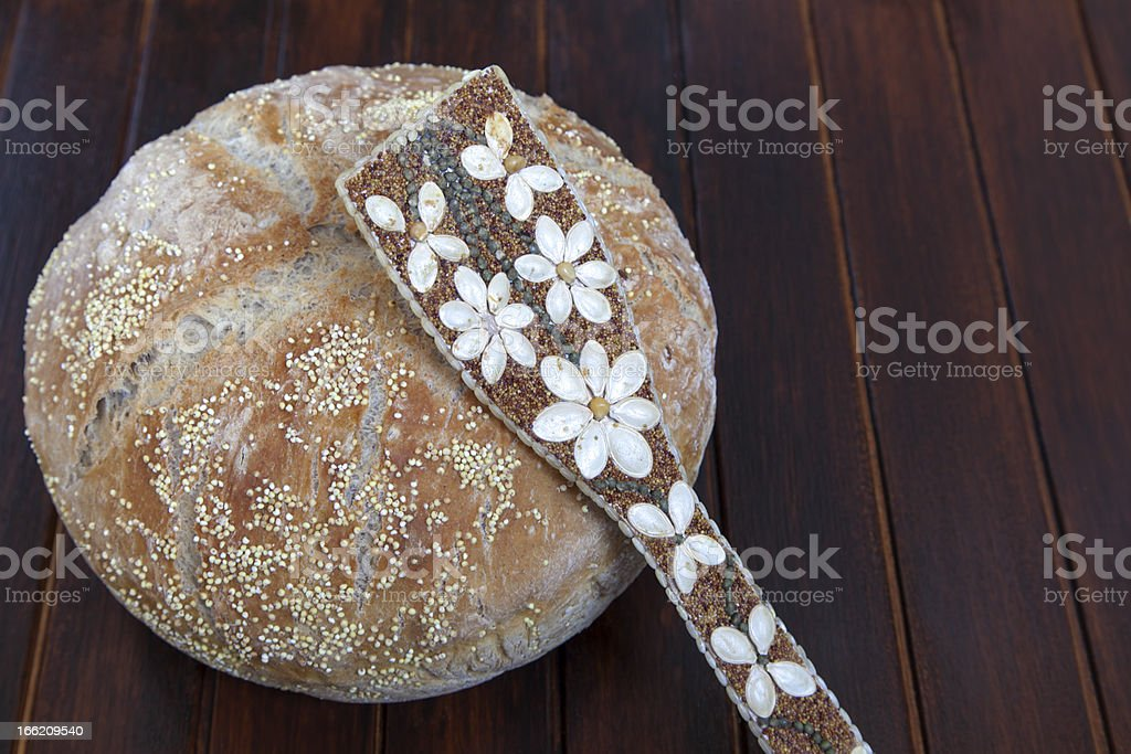 Organic bread and with various seeds strewn ladle royalty-free stock photo
