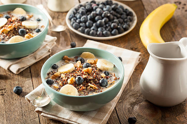 Organic Breakfast Quinoa with Nuts Organic Breakfast Quinoa with Nuts Milk and Berries porridge stock pictures, royalty-free photos & images