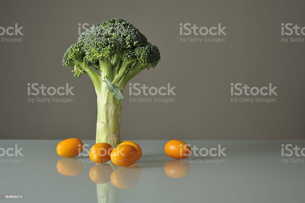 Organic Broccoli and Kumquat Fruit stock photo