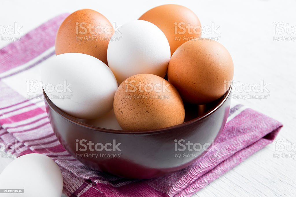 organic brown and white eggs stock photo