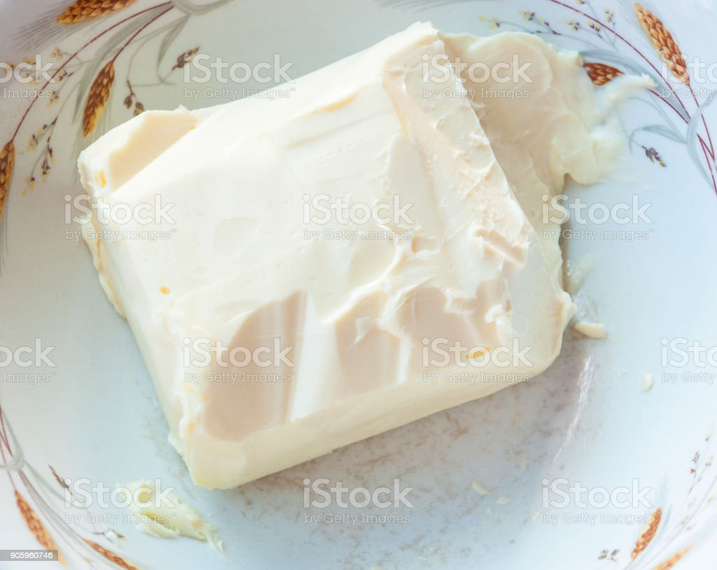 Organic butter in the white bowl. stock photo