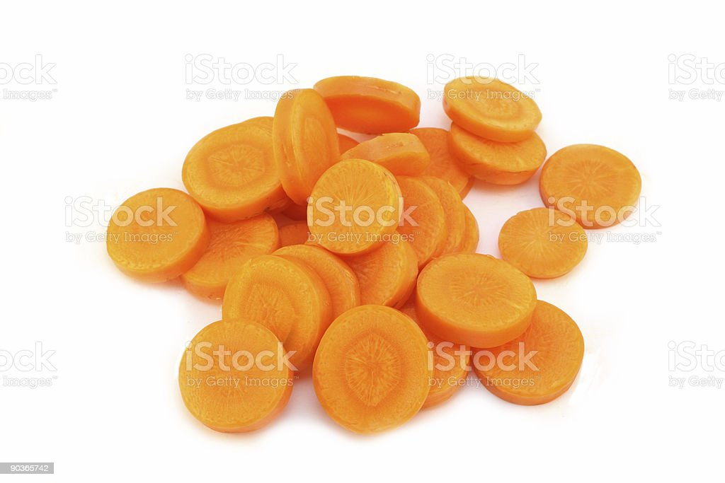 Organic carrot partially sliced - isolated on white stock photo