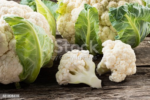 Organic cauliflower on wooden background