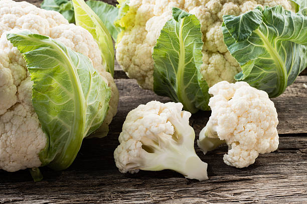 Organic cauliflower on wooden background stock photo
