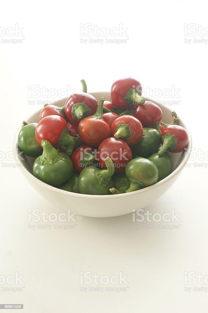 organic cherry paprika in a white bowl royalty-free stock photo