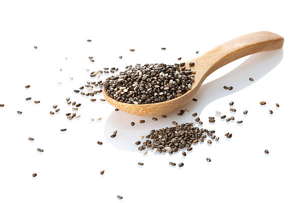 organic chia on white background - chia seed stock photos and pictures