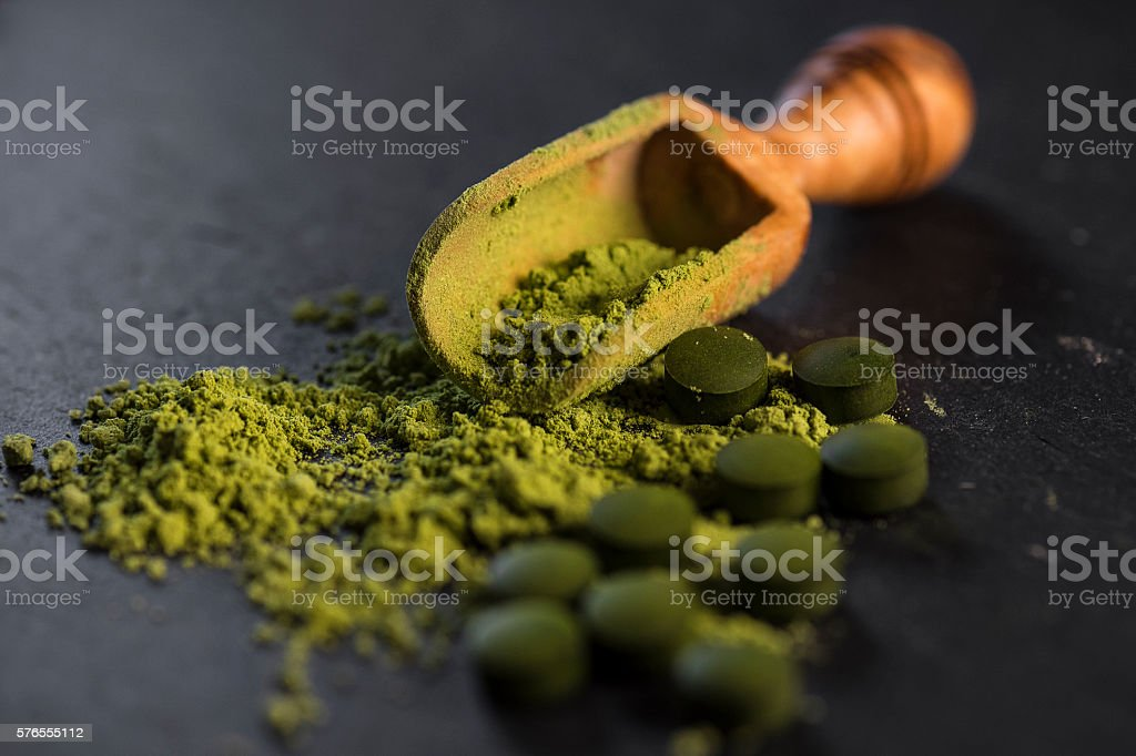 Organic Chlorella Powder and Tablets stock photo