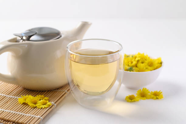 Organic Chrysanthemum flower tea in a cup and teapot stock photo