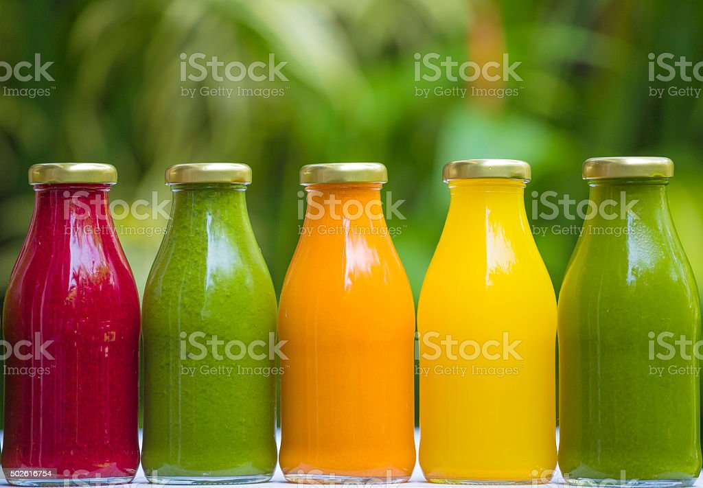 Organic cold-pressed raw vegetable juices stock photo