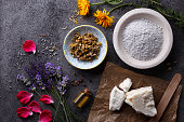Organic cosmetic ingredients on rustic stone background.