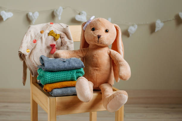 Organic cotton clothing and rabbit toy on the kids chair picture id1208353899?b=1&k=6&m=1208353899&s=612x612&w=0&h=aivoy3w0s13eyeyccqzkfikrvhdduaeuq6wjz9mzgmg=