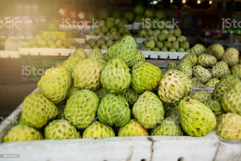 organic custard apple on basket in street market royalty-free stock photo