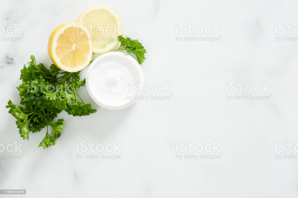 Organic Dermatology Cosmetic Hygienic Cream In Glass Jar Parsley Citrus Lemon On White Marble Background Skincare Product Bio Organic Cosmetic Natural Facial Or Body Cream Concept Stock Photo Download Image Now