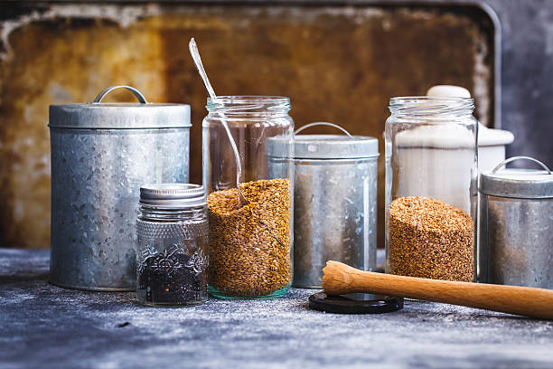 Organic Dry Chia and Flax Seeds In Glass Jars stock photo