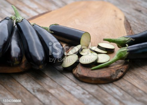Organic eggplants on wood background