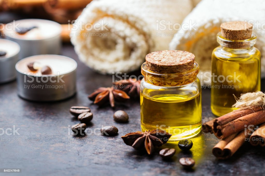 Organic essential oil with coffee spices cinnamon, spa concept stock photo
