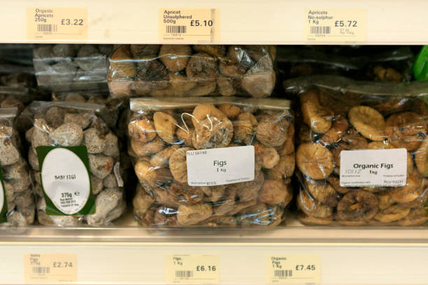 Organic Figs for sale on the shelf of a health food store in Dorchester UK stock photo