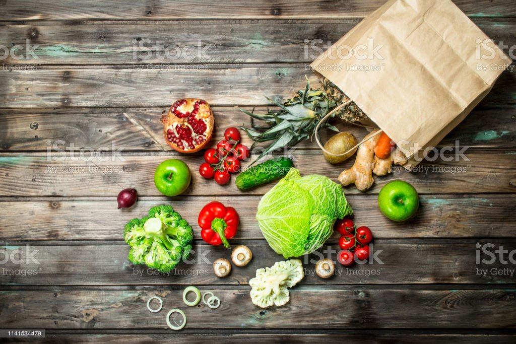 Organic food. Food package with healthy vegetables and fruits. On a...