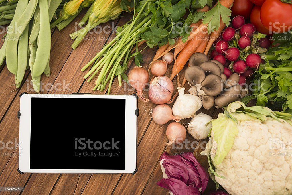 organic food mix with digital tablet royalty-free stock photo
