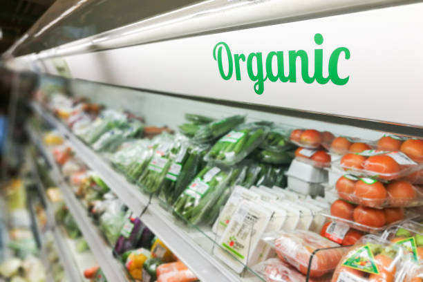 organic food signage on modern supermarket fresh produce vegetable aisle - organic stock pictures, royalty-free photos & images
