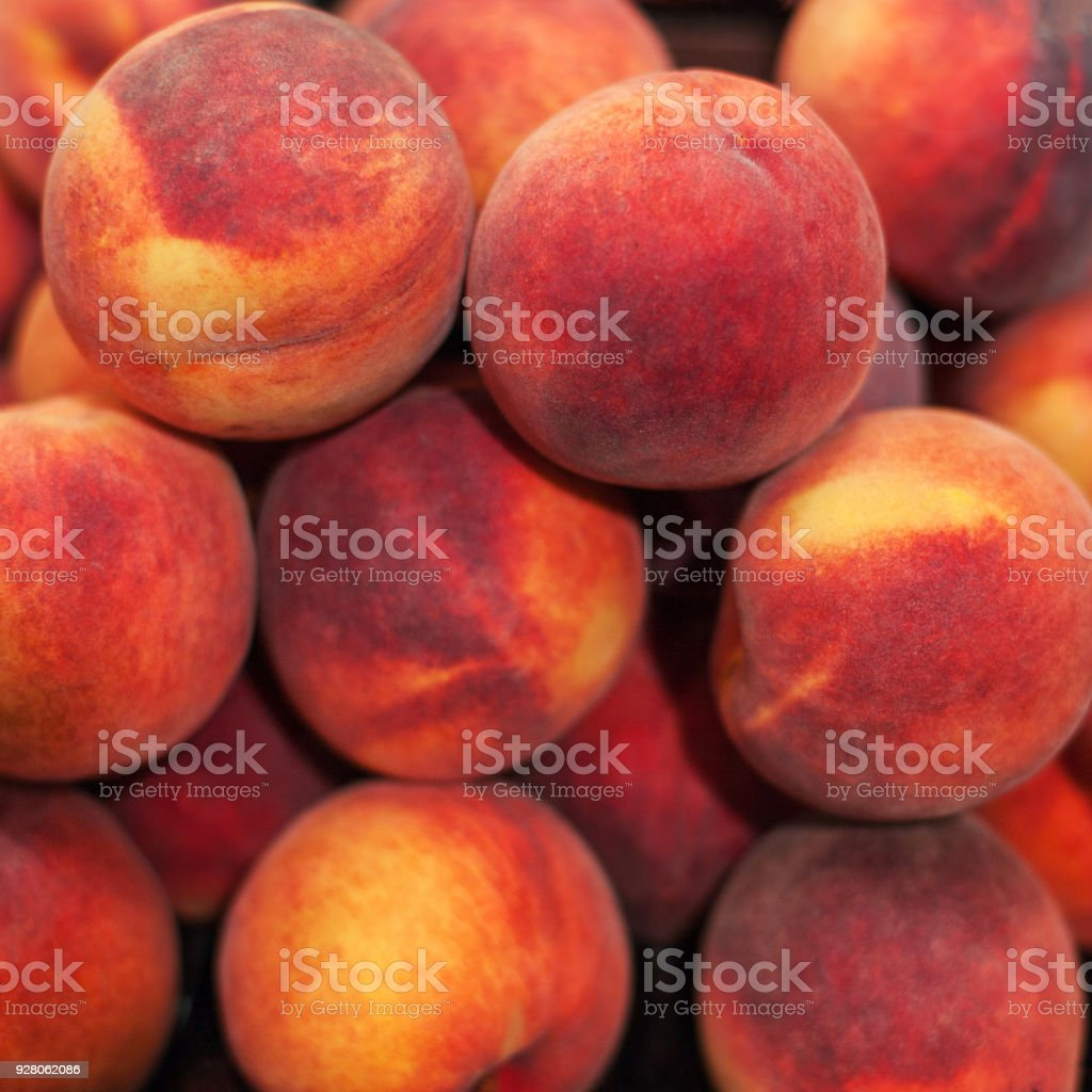 Organic Fresh nectarines in the market.  Nectarine harvest.  Food background stock photo