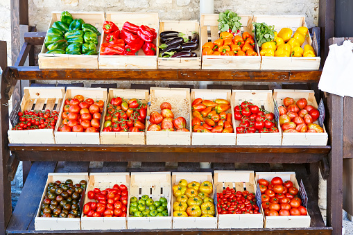 Organic fresh different tomatoes from mediterranean farmers market. Healthy local food market. Variety of tomatoes: green, red, yellow, black. Market in Italy