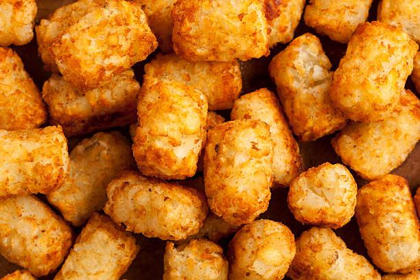 organic fried tater tots - aardappel stockfoto's en -beelden