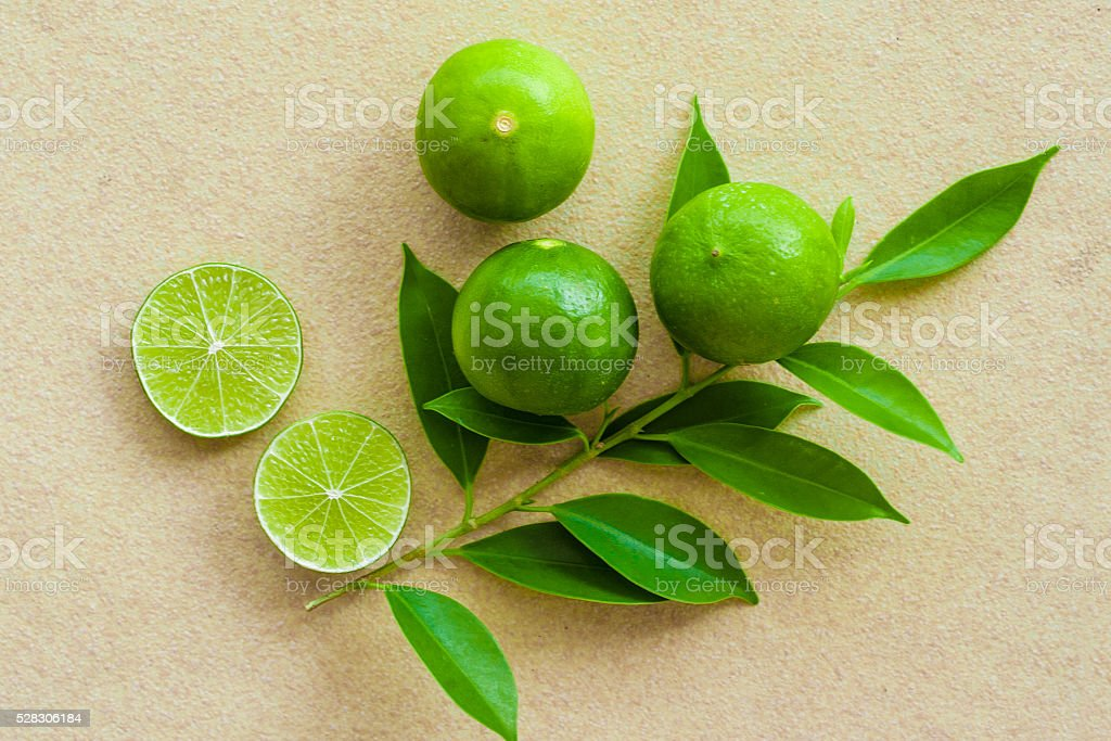 organic fruit lime on sandstone background stock photo