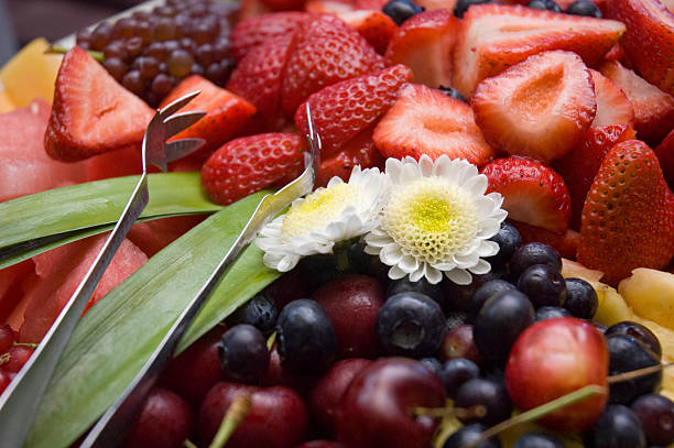 Organic Fruit Plate with Edible Flowers stock photo