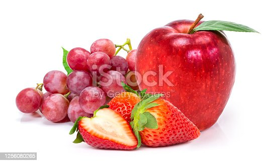 Closeup pile of different fresh organic fruits ( red berry strawberry, washington  apple and red grape fruit ) isolated on white background.