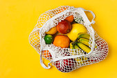 istock Organic fruits variety in cotton mesh reusable shopping bag - recycling, sustainable lifestyle, zero waste, no plastic. 1138248622