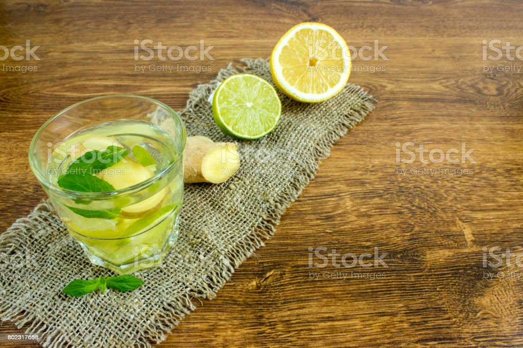 Organic Ginger Ale Soda in a Glass with Lemon and Lime stock photo