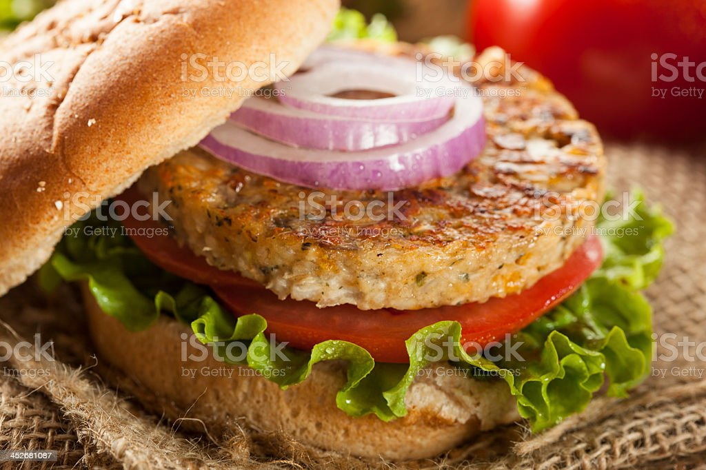 Organic grilled black bean burger and vegetables on a bun stock photo